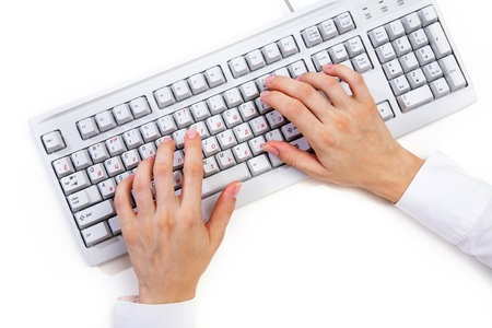 computer keyboard keys: Female hands typing on white computer keyboard on white desk