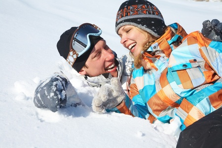 Young playful couple having fun in the snow Stock Photo - 10560402