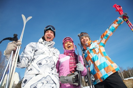 skiers: Portrait of group of friends with skis