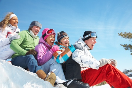 recreational: Group of  teenagers slide downhill in wintertime Stock Photo