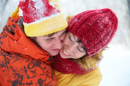 young pair kisses in the winter Valentine photo