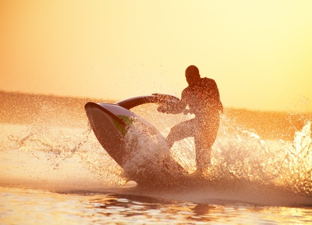 water  skier: gorgeous summer sunset on a big lake in red paint Stock Photo