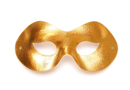 Gold carnival mask on a white background photo