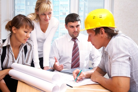Meeting the team of engineers working on a construction project at the table Stock Photo - 10588618