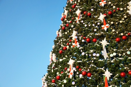 huge christmas tree: part of large outdoor Christmas tree in snow and ornaments