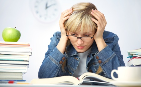 despondency: Intelligence girl student reads books in the library Stock Photo