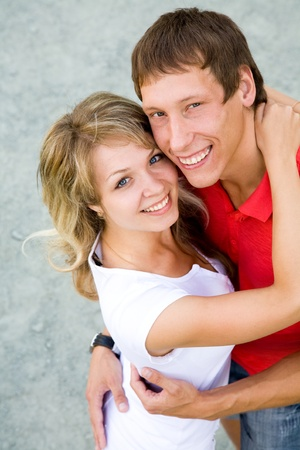 Portrait of a beautiful young couple are happily embracing at walk. Top view Stock Photo - 10603171