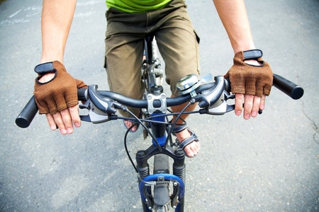 Close-up of human hands on handlebar photo