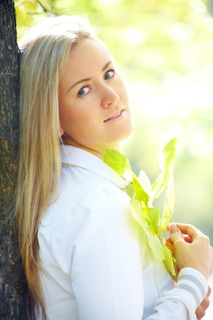 Portrait of a beautiful blonde woman in autumn park Stock Photo - 10718737