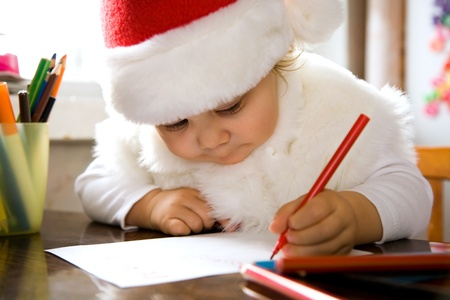 Little girl writes letter to Santa  photo