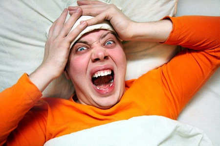 Portrait of man having headache in bed with fever photo