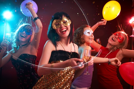 masked woman: Dance happy young girls under masks on the party