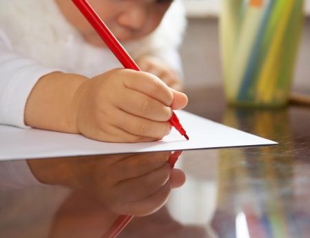 small child writes the letter to Santa Stock Photo - 10932796