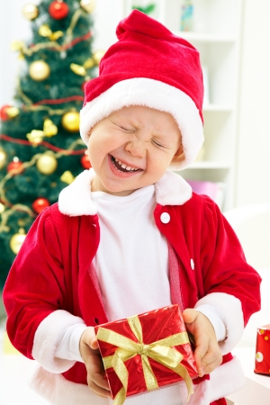 Portrait of little boy with Christmas presents Stock Photo - 11120473