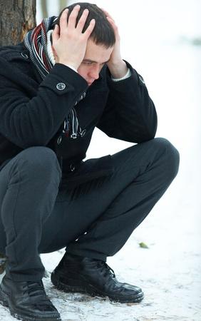 Portrait of man in despair outdoors photo