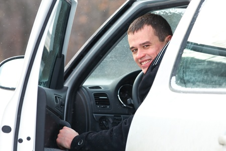 Portrait of handsome man in car in winter photo