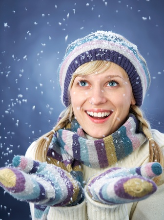 WINTER PORTRAIT OF BEAUTIFUL SMILING WOMAN WITH SNOWFLAKES Stock Photo - 11161408
