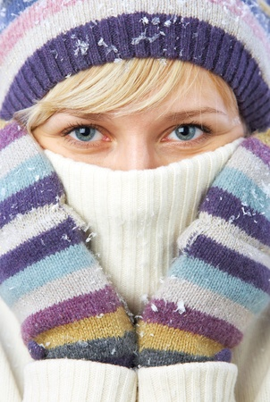 PORTRAIT OF WOMAN WEARING TURTLE NECK, WINTER HAT AND SCARF Stock Photo - 11161453