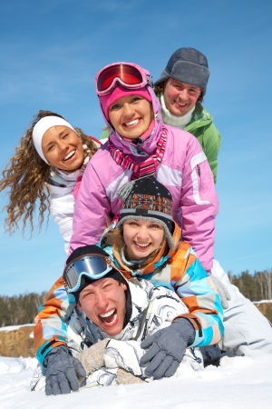 Group of young friends enjoying wintertime photo
