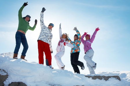 happy people jumping: Group of  teenagers dansing together in wintertime Stock Photo