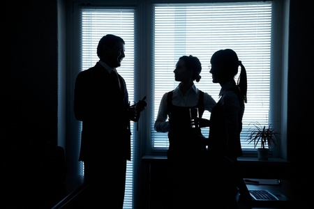 silhouettes of business partners discuss against the window in the office Stock Photo - 11223770