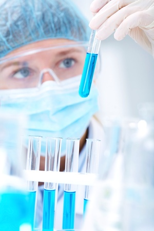 Medical or scientific researcher or doctor using looking at a solution in a laboratory Stock Photo - 11334170