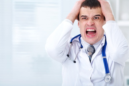 doctor stress: Portrait of male doctor having bad news