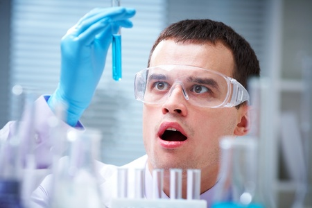 Medical or scientific researcher or doctor using looking at a solution in a laboratory  Stock Photo - 11334184