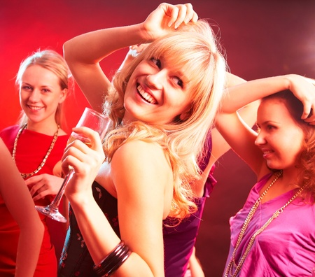 Dance happy young girls under masks on the party Stock Photo - 11334198