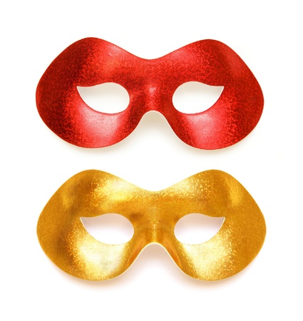 Gold and red carnival masks on a white background photo