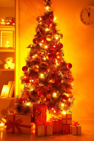 A lighted Christmas tree with presents underneath in living room Stock Photo - 11334218