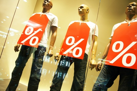 store window: mannequins with shopping bags in a clothing store Stock Photo
