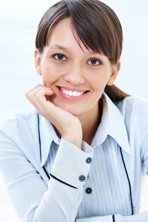 Young businesswoman smiling and looking to camera photo