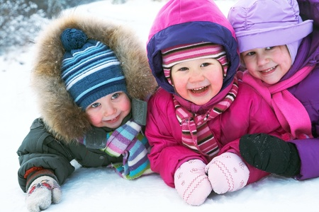 Group of children having fun in winter time Stock Photo