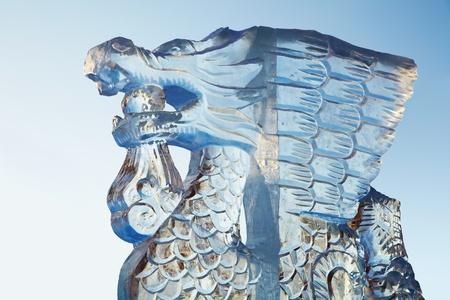 Ice figure of ice glistening in the sun against the blue sky photo