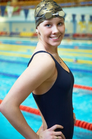 swimmers: Portrait of Female professional competitive swimmer in swimming pool