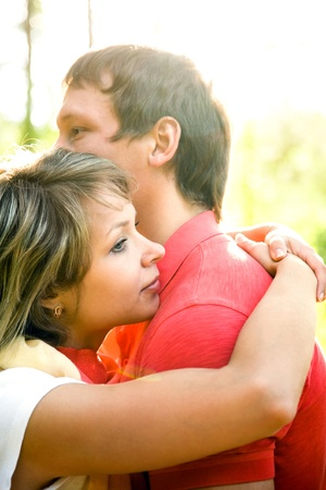 Portrait of a beautiful young couples are happily embracing at walk  Stock Photo - 12170260
