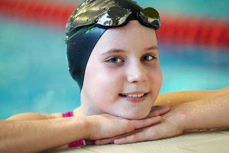 Portrait of girl swimmer in swimming pool  photo