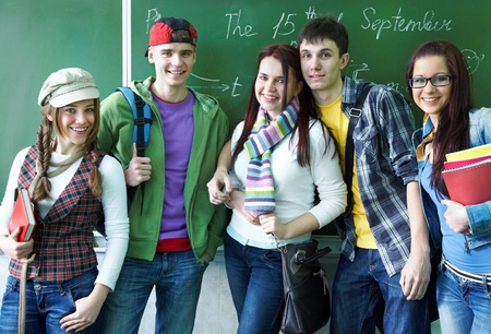 Portrait of six teens in classroom background green board Stock Photo - 12467302