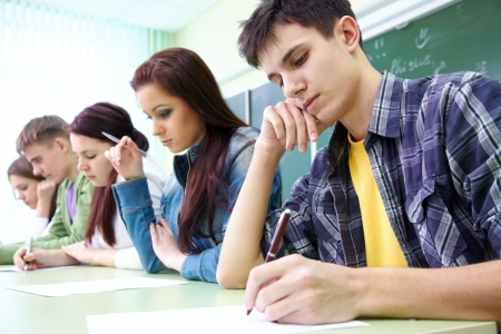 group study: group of students takes the test in class Stock Photo