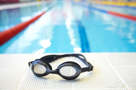 swimming competition: Image of swimming pool and goggles. Nobody