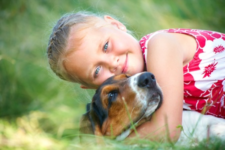 dog portrait: Portrait of cute girl with dog on summer meadow