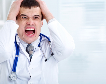 Portrait of male doctor having bad news photo