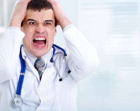 hospital stress: Portrait of male doctor having bad news