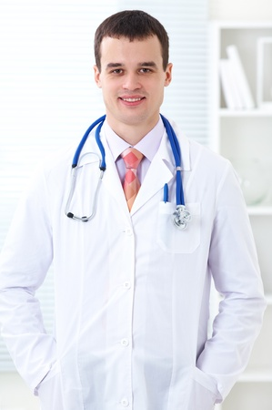 Portrait of male doctor wearing lab coat and stethoscope Stock Photo - 12508096