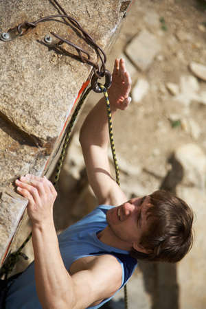 Photo of young man climbing up the rock Stock Photo - 12508144