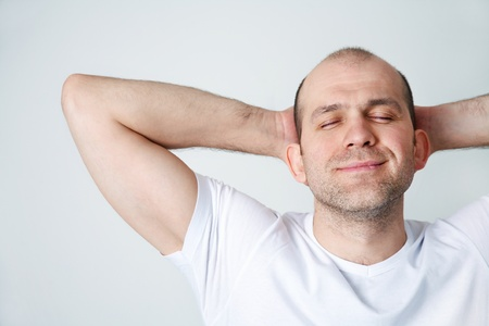 favourable: Portrait of positive bald-headed smiling man on white background Stock Photo