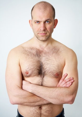 Portrait of topless handsome man on white background photo