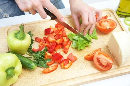 Human hands  cooking vegetables salad in kitchen   photo
