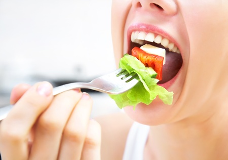 eat: close-up of woman eating fresh salad